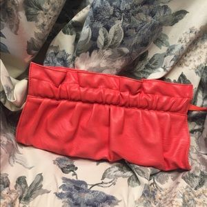 Express clutch in coral or salmon